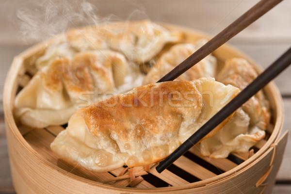 Chinese dish pan fried dumplings Stock photo © szefei