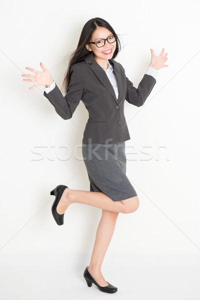 Happy Asian businesswoman Stock photo © szefei
