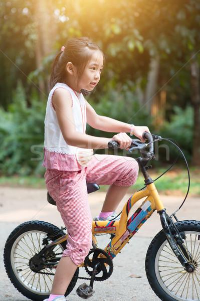 Asiático criança ciclismo ao ar livre retrato ativo Foto stock © szefei