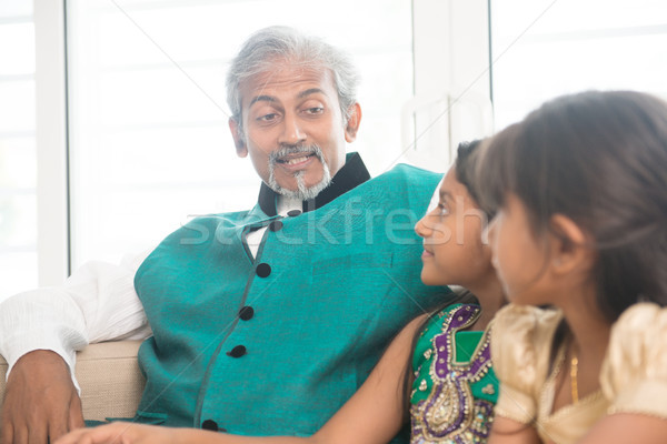 Happy Indian parent and children at home Stock photo © szefei