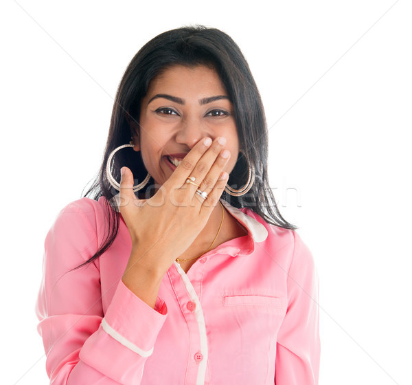 Indian woman giggles covering her mouth with hand Stock photo © szefei