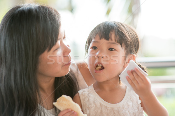 Child eat and wipe mouth  Stock photo © szefei