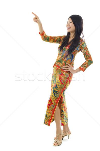 Asian female pointing Stock photo © szefei