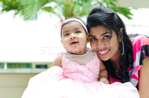 Indian mother and baby girl Stock photo © szefei
