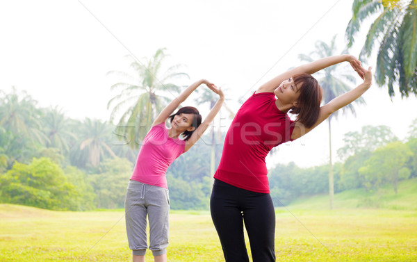 Asian girls streching outdoor Stock photo © szefei