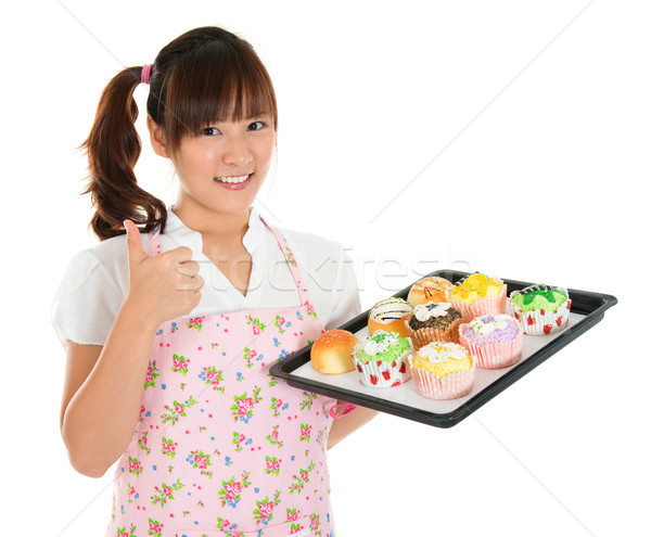 Thumb up Asian female baking Stock photo © szefei