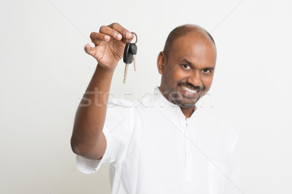 Mature Indian man holding car key Stock photo © szefei