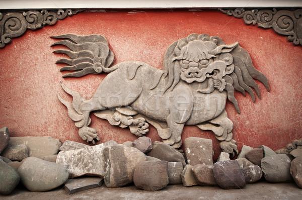 Carved animal at monastery Stock photo © szefei