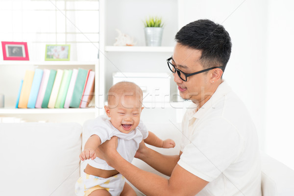 Father and baby boy playing Stock photo © szefei