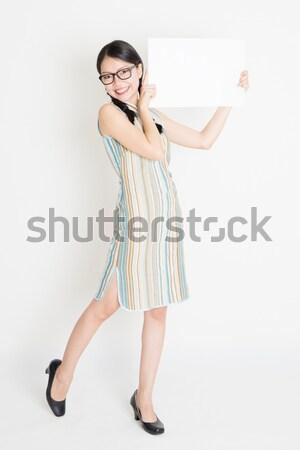 Asian woman unsure Stock photo © szefei