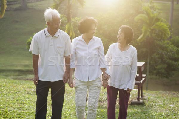 Group of Asian seniors walking at park Stock photo © szefei