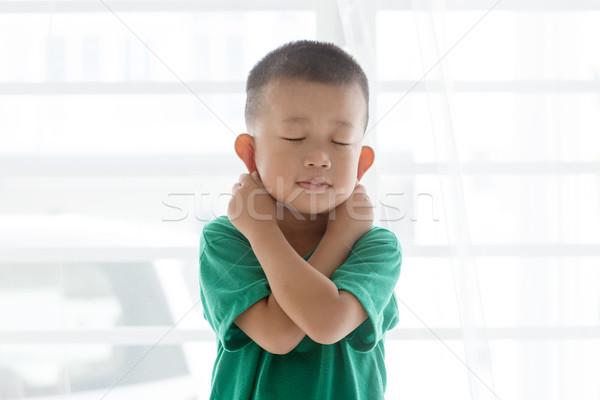 Playful boy pulling ears Stock photo © szefei