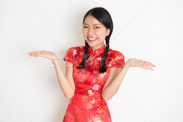 Asian chinese girl showing palm Stock photo © szefei