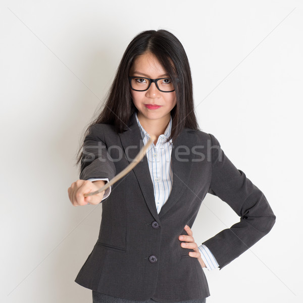 Asian female teacher holding a stick Stock photo © szefei