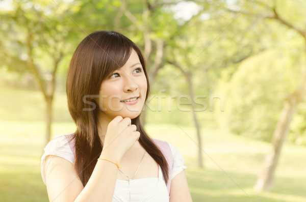 Asian college girl student thinking Stock photo © szefei