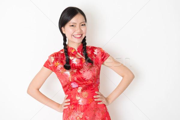 Oriental girl in red qipao smiling Stock photo © szefei