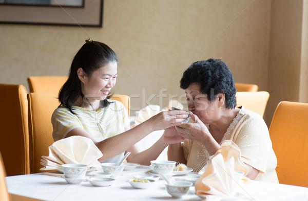 Asian Chinese family having meal Stock photo © szefei