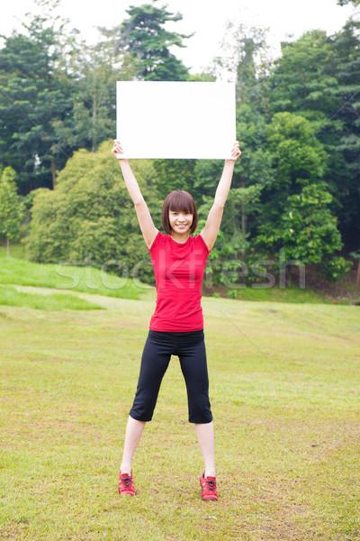 Outdoor Asian girl with placard Stock photo © szefei
