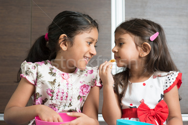 Stock photo: Sibling eating foods