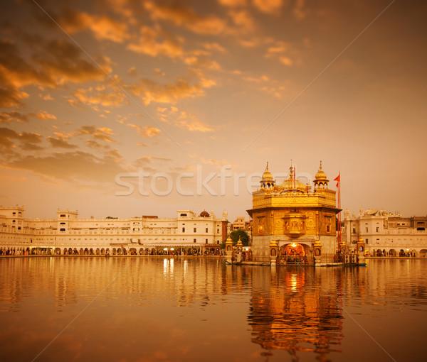 Gouden tempel zonsopgang water aanbidden wolk Stockfoto © szefei