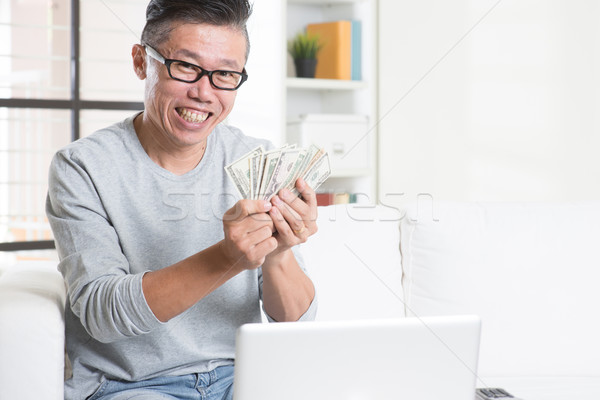 Earning money from online business Stock photo © szefei