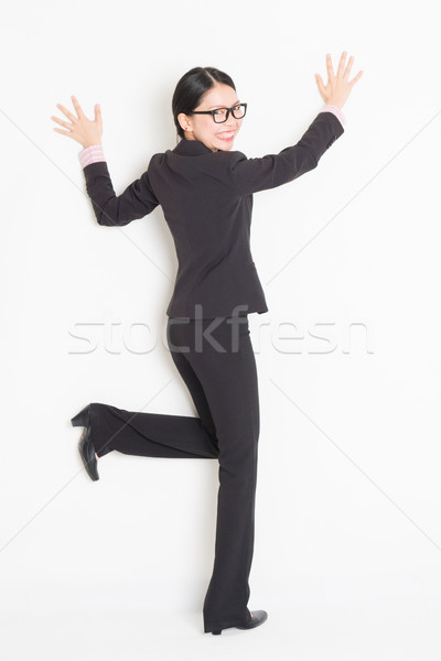 Asian businesswoman hands touching on wall Stock photo © szefei