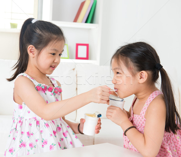 Children eating yoghurt  Stock photo © szefei