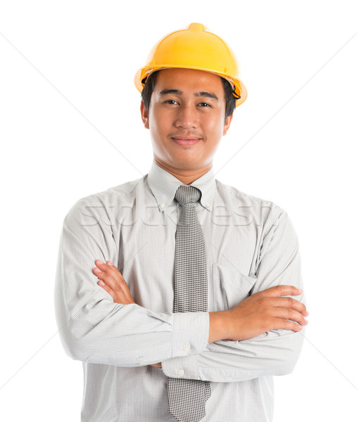 ázsiai férfi visel citromsárga munkavédelmi sisak közelkép Stock fotó © szefei