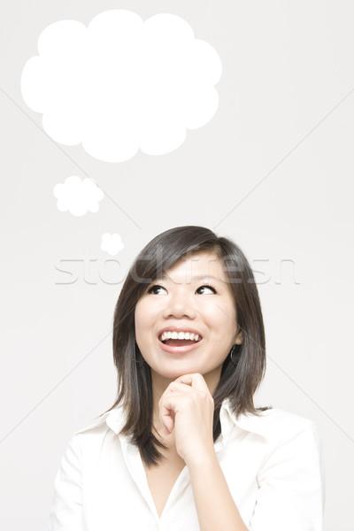 Pensamiento joven burbuja de pensamiento negocios mujer nina Foto stock © szefei