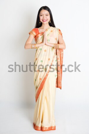 Southeast Asian female in batik dress  Stock photo © szefei