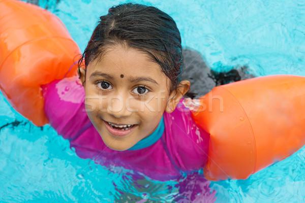Child swimming Stock photo © szefei