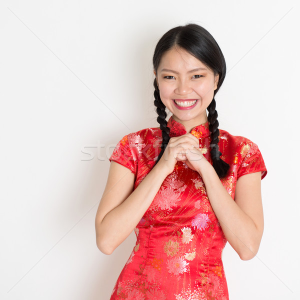 Asian chinese girl congratulating Stock photo © szefei