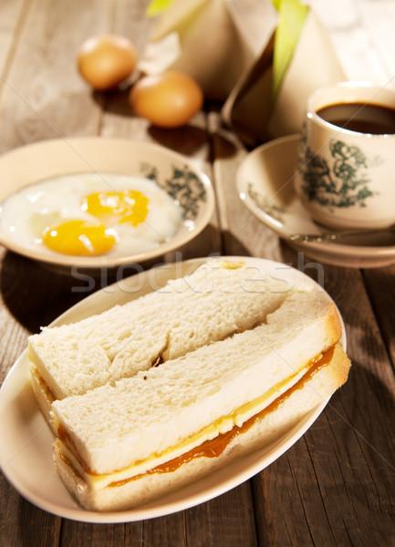 Traditional Malaysian breakfast kaya butter toast and coffee Stock photo © szefei
