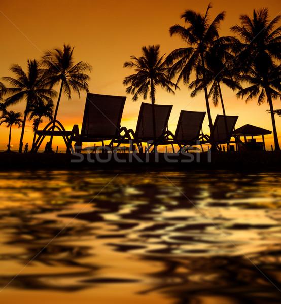 Trópusi naplemente csetepaté víz tükröződés tengerpart Stock fotó © szefei