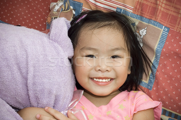 Asian girl with her soft toy Stock photo © szefei