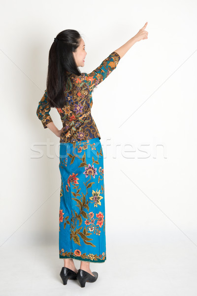 Asian girl pointing Stock photo © szefei