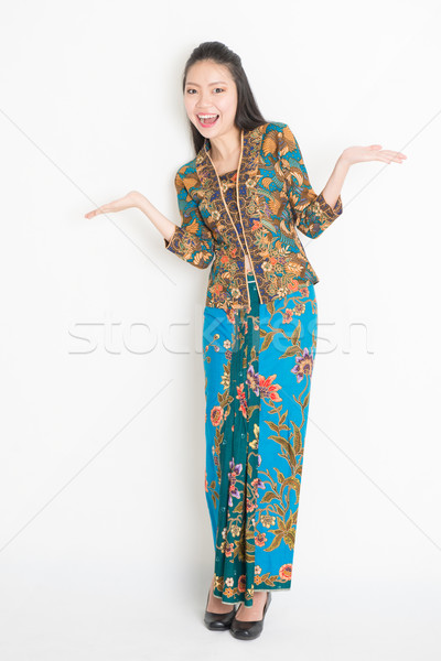 Girl showing something Stock photo © szefei
