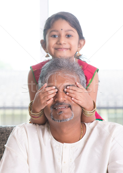 Stock photo: Daughter playing with father