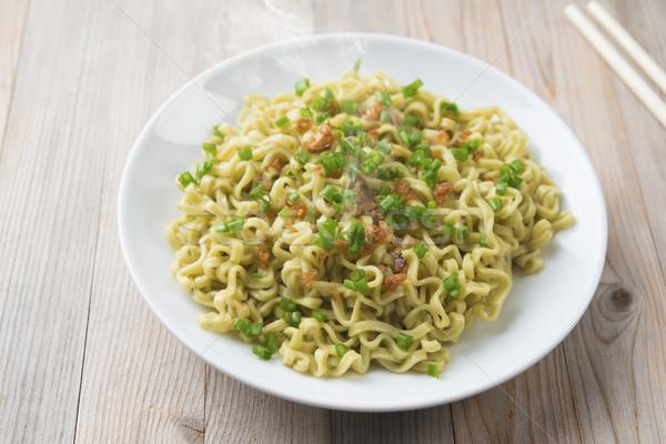Dried noodles on plate Stock photo © szefei