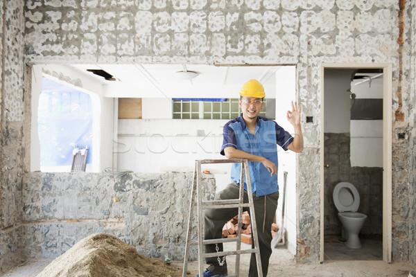 Obcy pracownika domu asian pracownik budowlany uśmiechnięty Zdjęcia stock © szefei