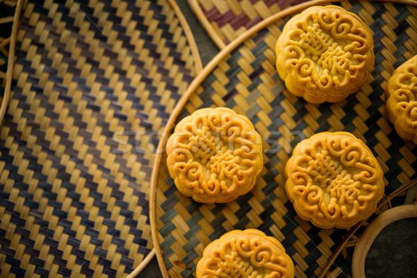 Mooncakes on bamboo background low light  Stock photo © szefei