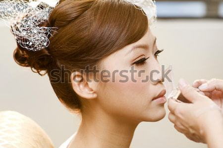 Applying makeup. Stock photo © szefei