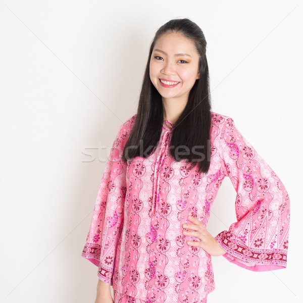 Asian girl in pink batik dress Stock photo © szefei