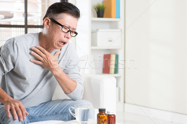 Mature Asian man cough Stock photo © szefei
