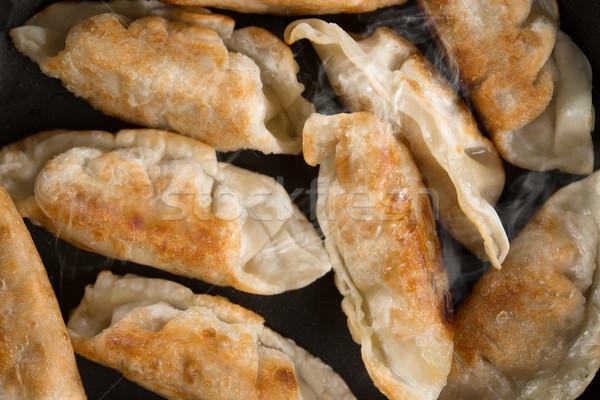 Close up Asian food fried dumpling in cooking pan Stock photo © szefei