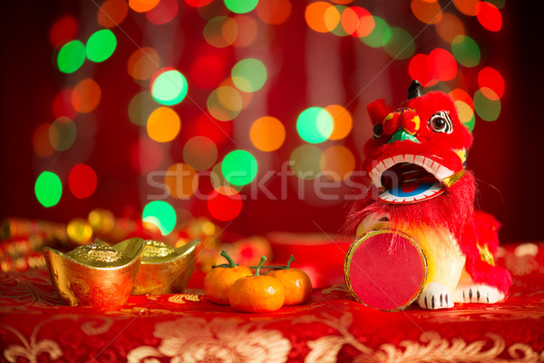 Chinese New Year objects on red glitter background Stock photo © szefei