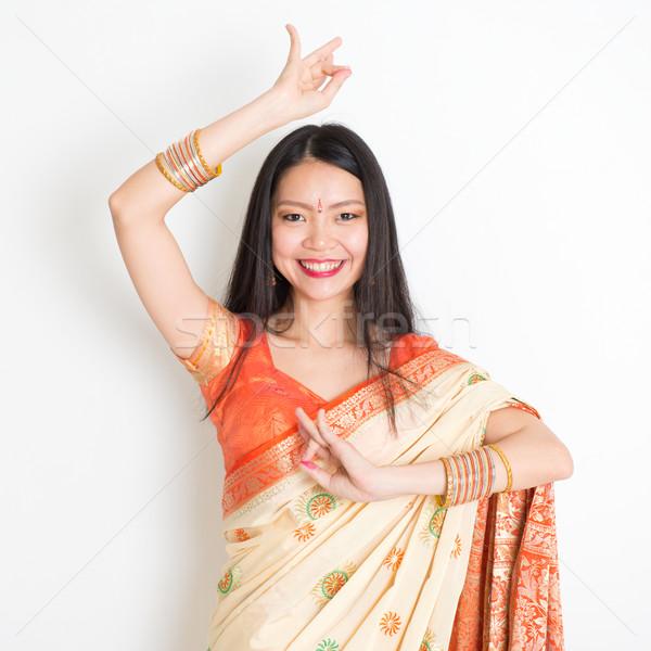 Young girl in Indian sari dress dancing Stock photo © szefei