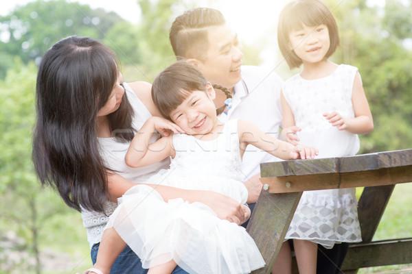 Happy Asian family bonding at outdoor with empty table  Stock photo © szefei