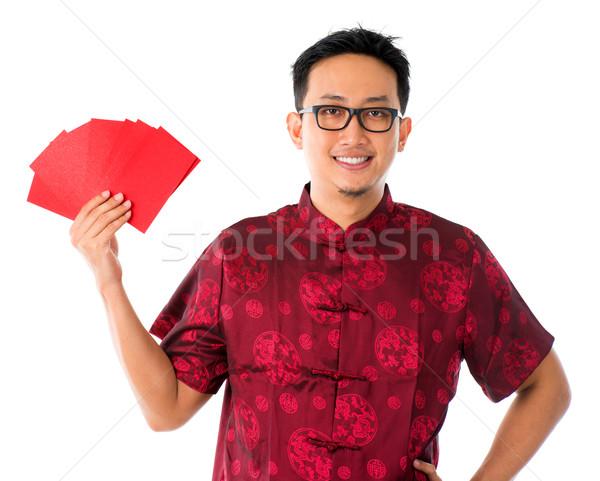 Southeast Asian male in cheongsam  Stock photo © szefei