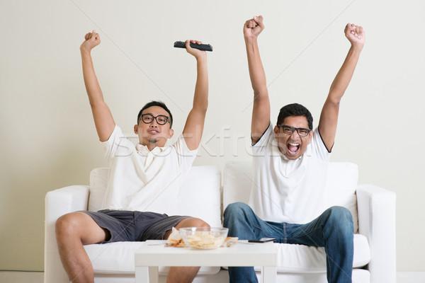 Stok fotoğraf: Erkekler · izlerken · futbol · maç · tv · birlikte
